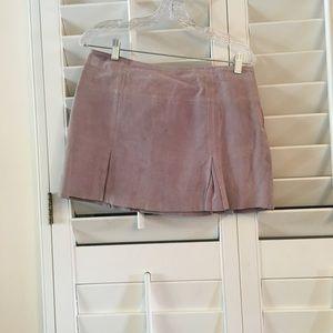 Light lavender leather mini skirt.